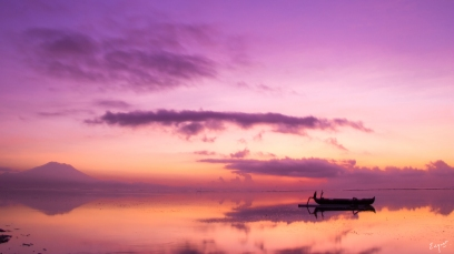 Silhouette of a boat with the morning sky as the background