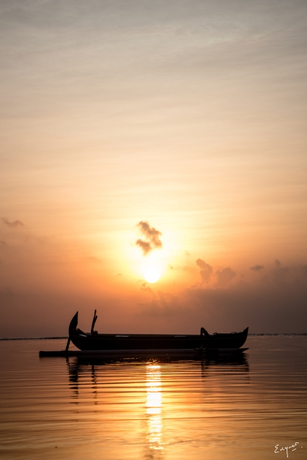 A boat silhouette at sunrise