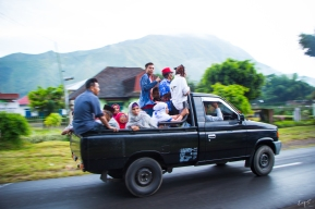 A group of people is usually transported using pick-up trucks